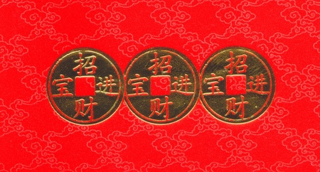 Chinese gold coin on red background photo
