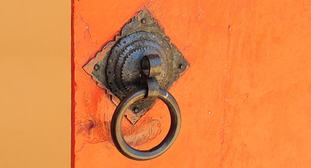 Chinese handle style onorange door photo