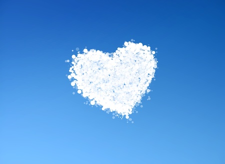Cloud shaped heart on a clear sky background photo