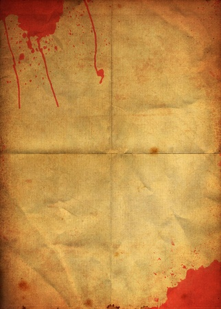 Blood stain on old grunge folding paper background photo