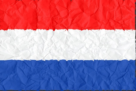 netherlands grunge flag on wrinkled paper background photo