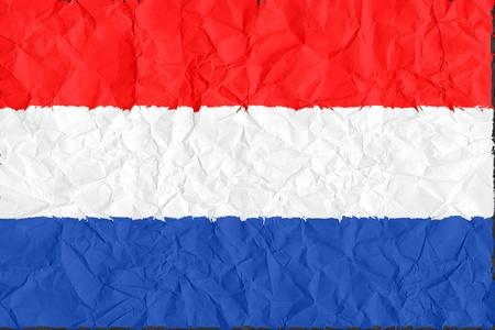 netherlands grunge flag on wrinkled paper background photo