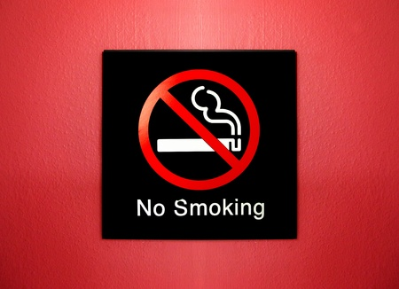 no smoking sign on red grunge wall        photo