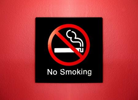 smoking ban: no smoking sign on red grunge wall