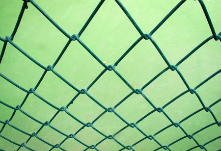 Old green wire mesh background                photo