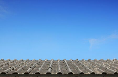 Old roof on the blue sky background photo