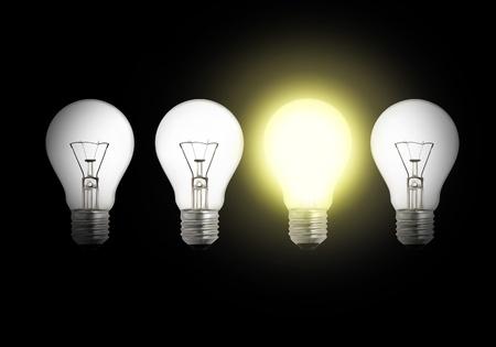 amongst: One lit light bulb amongst other broken light bulbs background