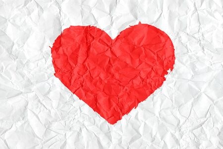 Painted textured valentine heart on white crumpled paper  Stock Photo - 13362132
