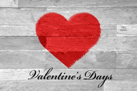 Red heart shaped painted on old wood wit valentine's day text background photo