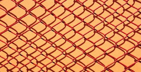 Red net metal steel on orange wall photo