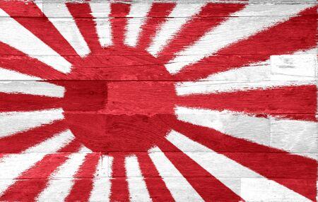 kamikaze: The military flag of Japan painted on old used wood background Stock Photo