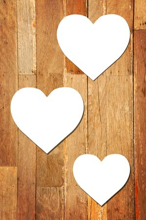 White paper heart on wood background photo