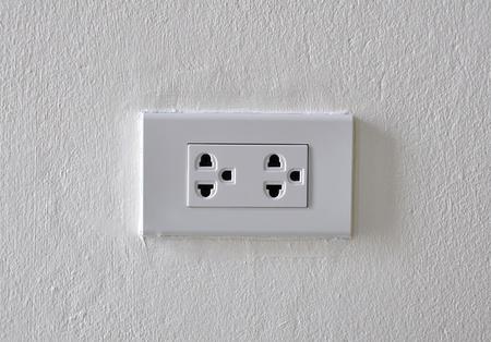 white plug on the white wall background Stock Photo - 13362181