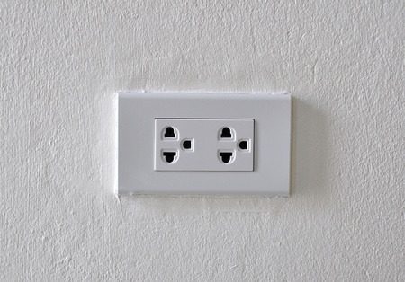 white plug on the white wall background Stock Photo - 13362181