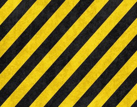 Yellow and black diagonal hazard stripes background photo