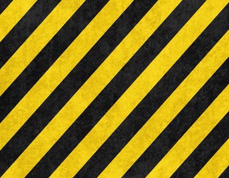 hazard stripes: Yellow and black diagonal hazard stripes background