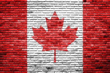 Canada flag painted on old brick wall texture background photo