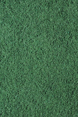 Close-up of a green cleaning sponge background photo