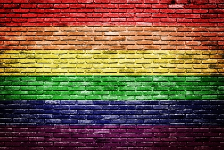 Rainbow flag painted on old brick wall texture background Stock Photo