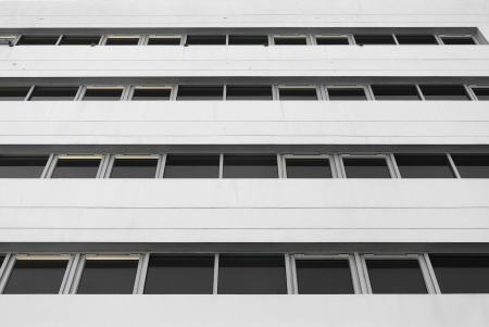 Wihite building with windows background photo