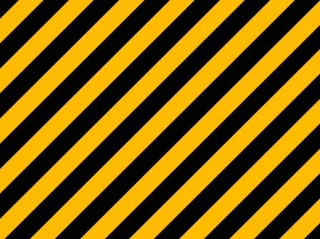 오래 된 벽돌 벽에 그려진 노란색과 검은 색 대각선 위험 줄무늬