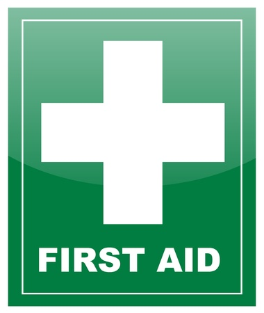 First Aid with white cross on green label Stock Photo