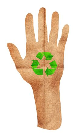 Green recycle sign on hand paper craft Stock Photo - 15115181