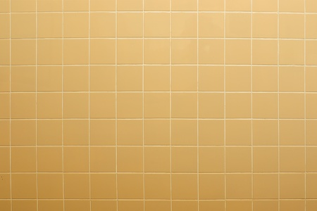 Yellow tiles wall textured background photo