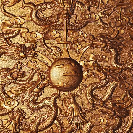 Gold dragon around the gold marble background photo
