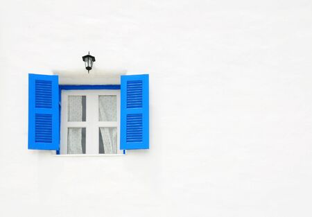 Blue window on the white wall with empty space photo