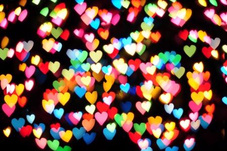 Defocused hearts on christmas light background