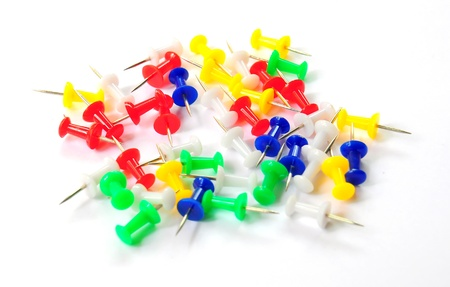 Stack of colorful thumbtacks on white Stock Photo