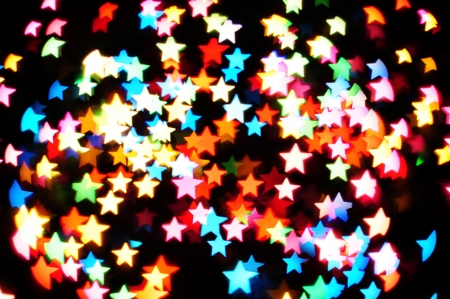 merry mood: Defocused star bokeh on christmas light Stock Photo