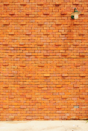 Lamp on orange brick wall background photo