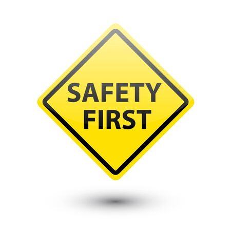 safety first: SAFETY FIRST yellow sign on white Stock Photo