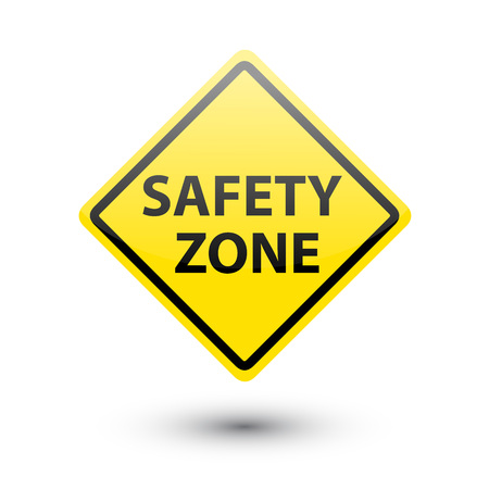 safety first: Safety zone yellow label sign on white