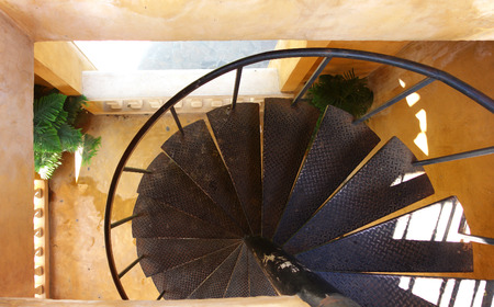 clambering: Spiral steel stairs in the building with green plant Stock Photo
