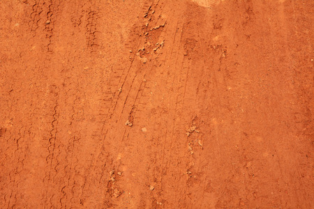 red soil: Wheel tracks on red soil rural road background