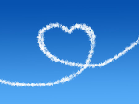 Heart shaped cloud in the blue sky background