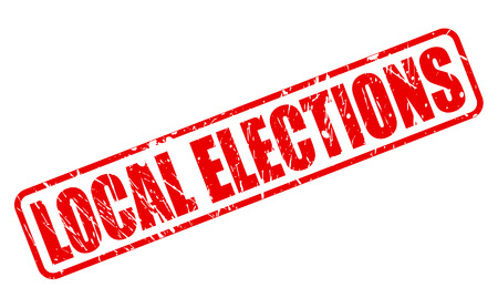 local council election: LOCAL ELECTIONS red stamp text on white Stock Photo