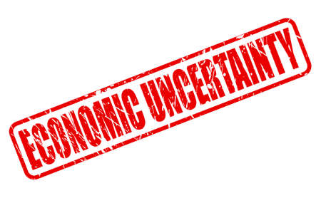 monetary policy: ECONOMIC UNCERTAINTY red stamp text on white