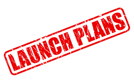 unveiling: Launch Plans red stamp text on white Stock Photo