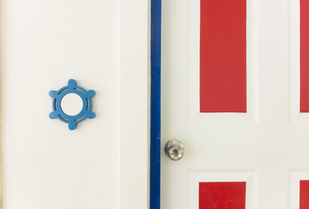 white and red wood door with blue door frame