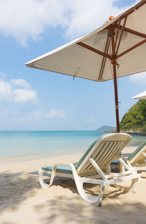 Chairs and umbrella on a tropical beach Banco de Imagens