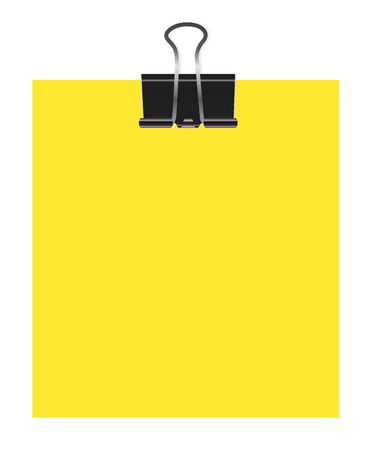 Bulldog clip on yellow paper
