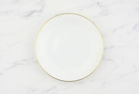White luxury plate on white marble background