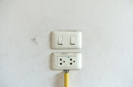 Old electric-switch on white background