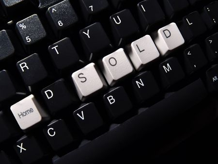black computer keyboard, with home sold word Stock Photo