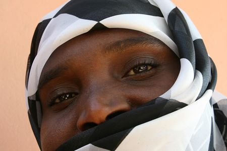 african muslim woman with a black and white veil photo