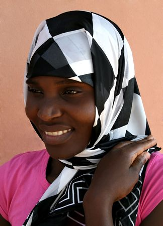 african muslim woman with black and white scarf photo